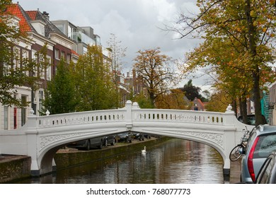Vintage white bridge over the canal in Delft, Holland.