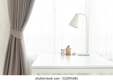 Vintage white lamp on the white table white green plant on the brown luxury curtain background in the  minimal style Living room