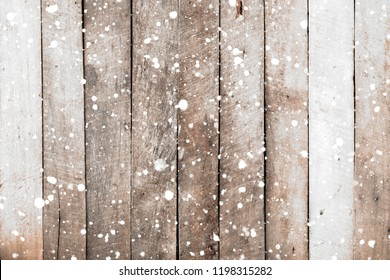 Vintage white wood wall with snow falling over. Christmas rustic background, winter scene.