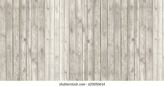 Vintage whitewash painted rustic old wooden  plank wall  textured background. Faded natural wood board panel structure .