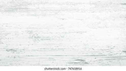 Vintage whitewash painted rustic old wood plank wall textured background. Faded washed natural wood board panel structure