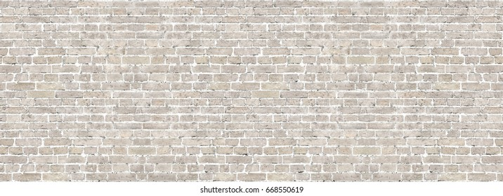 Vintage whitewashed brick wall panoramic background texture. Home and office design backdrop in modern style