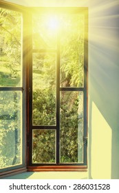 Vintage window with vivid sunlight passing through