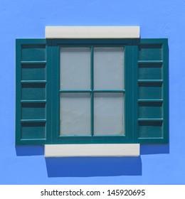 vintage windows on the blue wall