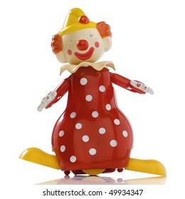 a vintage windup toy clown