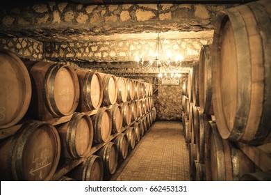 Vintage winery cellar with wine barrels