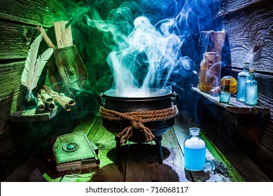 Vintage witcher cauldron with magic potions and books for Halloween