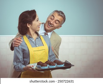 Vintage woman in apron cooking chocolate muffins for her husband