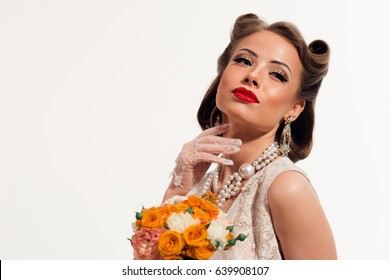 Vintage woman with red lips holding flowers