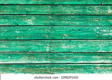 Vintage wood background with peeling grunge paint.