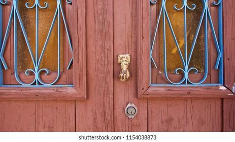 vintage wood door detail with windows and handles