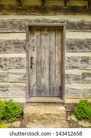 Vintage wood door on a log cabin