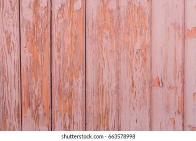 Vintage wood pink background with peeling paint