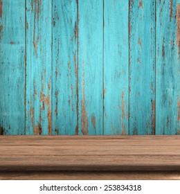 Vintage wood table in wood wall room.