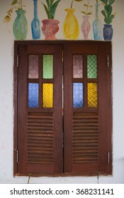 Vintage wood window with colorful paint.