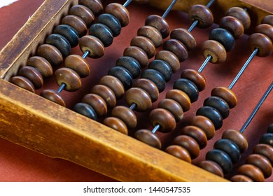 Vintage wooden abacus close up. Fragment of old abacus close up