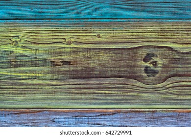 Vintage wooden background of colorful boards. Texture of natural wood, beautiful cut of coniferous wood