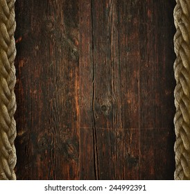 Vintage wooden background with the old rope
