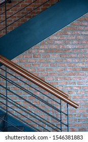 Vintage wooden black metal banister stairs and brick wall interior decoration contemporary