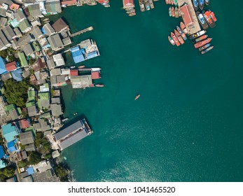 Vintage wooden boat in coral sea. Boat drone photo. Aerial view of coast line.