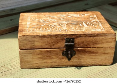 Vintage wooden box decorated with handmade floral pattern. Rustic decor elements