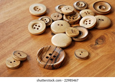 Vintage wooden buttons on wood background.  Macro with shallow dof.