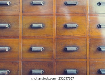 Vintage wooden card catalog with drawer handle Background pattern