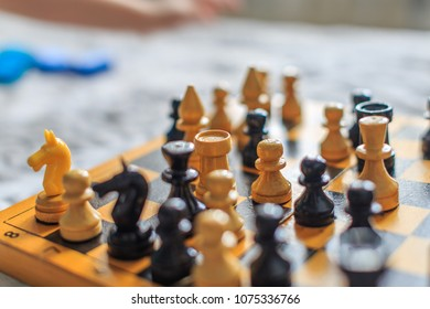 Vintage wooden chess on the chess board close-up
