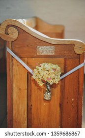 Vintage wooden church pew. An old-time Louisiana style church pew decorated with yellow flowers located at Acadian Village in Lafayette, Louisiana.