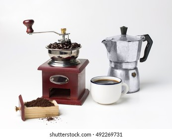 Vintage wooden coffee grinder coffee bean and moka pot on white background