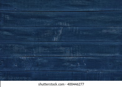 Vintage wooden dark blue horizontal boards. Front view with copy space. Background for design