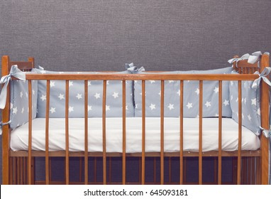 Vintage wooden decorated empty baby cot