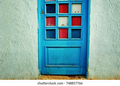 Vintage wooden door with colorful glass