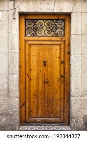 Vintage wooden door in  old stone wall
