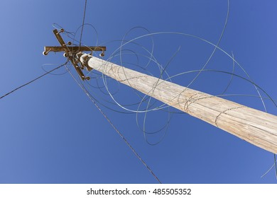 vintage wooden electricity mast or telephone pole, with demolished wire. concept for connection and disconnection