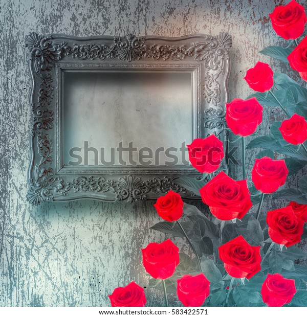 Vintage wooden frame with red rose and green leaves on the gold abstract background