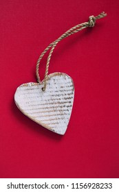 vintage wooden heart on red background