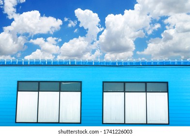 Vintage wooden house and white windows with cloud and blue sky.