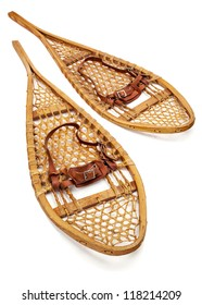 vintage wooden Huron snowshoes with leather binding on white