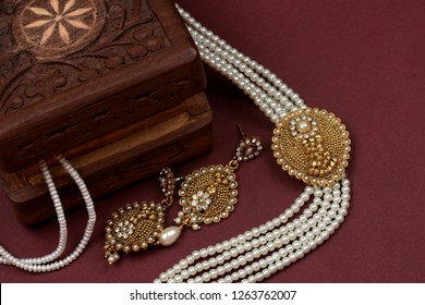 Vintage wooden jewellery box with Indian traditional jewelry, pearl earrings, pearl bracelet Luxury female jewelry, Indian traditional jewellery,Bridal Gold wedding jewellery, pearl jewelry
