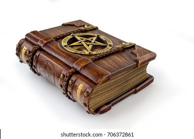 Vintage wooden - leather Grimoire book laying on the table