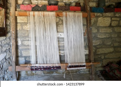 Vintage wooden loom for carpet.  Traditional wooden carpet weaving loom