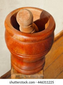A vintage wooden mortar and pestle from an pharmacy, with copy space.