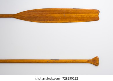Vintage Wooden Paddle Oars Close Up on White Background