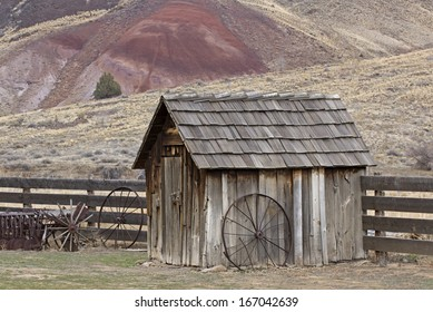 Vintage wooden pump house with wagon wheel in desert