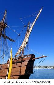 Vintage wooden Sailing Ship against a blue sky background