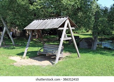 Vintage wooden seesaw swing for rest in garden