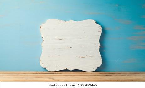 Vintage wooden sign board over rustic background