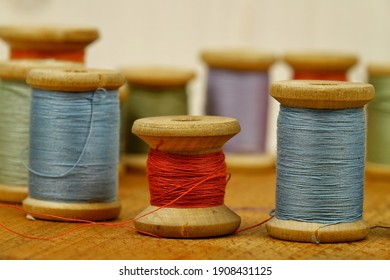 Vintage wooden spools of thread for sewing