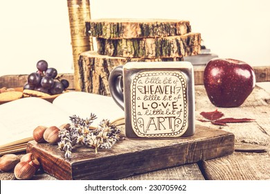 Vintage wooden table with tea cup and old book for relaxing